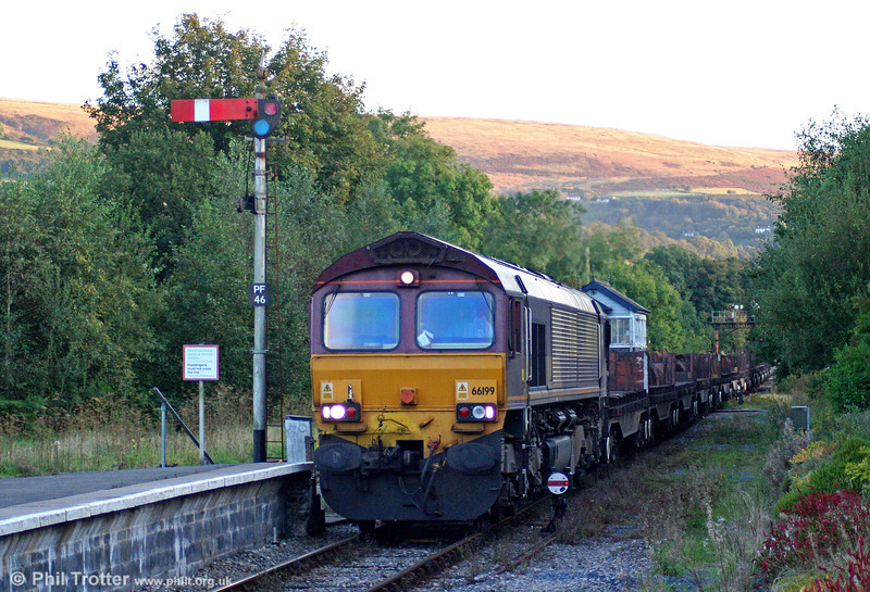 Closure of the South Wales Main Line for engineering work on 19/20 September resulted in a number of freight diversions over the Heart of Wales Line. In fading light, 66199 passes Pantyffynnon with 6E30, 1742 Margam to Hartlepool via Craven Arms on 20th September 2009.