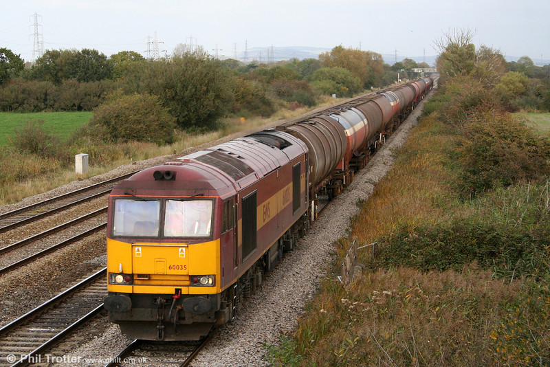 60035 passes Coedkernew at the head of 6B33, 1212 Theale to Margam on 17th October 2009.
