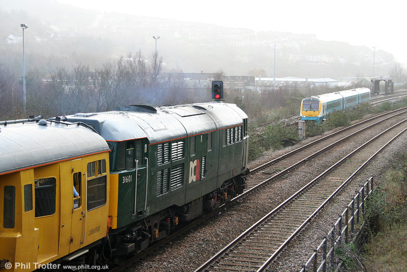 31601 waits for ATW 175103 (working the 1100 Carmarthen to Manchester Piccadilly) to clear Swansea Loop East Junction on 9th December 2009.
