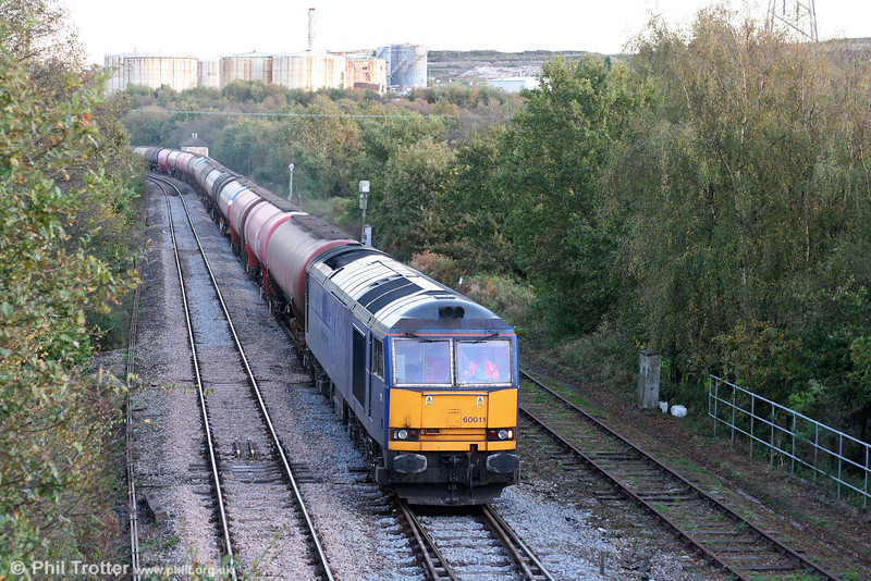 Mainline blue 60011 passes Llandarcy with 6B07, 1800 Margam to Robeston Oil Refinery on 12th October 2009.