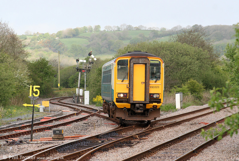 Difficult to get your verticals right here; everything leans! 153323 emerges from the Pembroke Dock branch at Whitland forming the 0705 Pembroke Dock to Swansea on 9th May 2009.