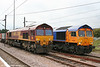 Spot the difference: Class pioneer 66001 alongside GBRf/Metronet 66720 'Metronet Pathfinder', the latter working 4E33, 1100 Felixstowe to Doncaster Railport at Peterborough on 4th August 2009.