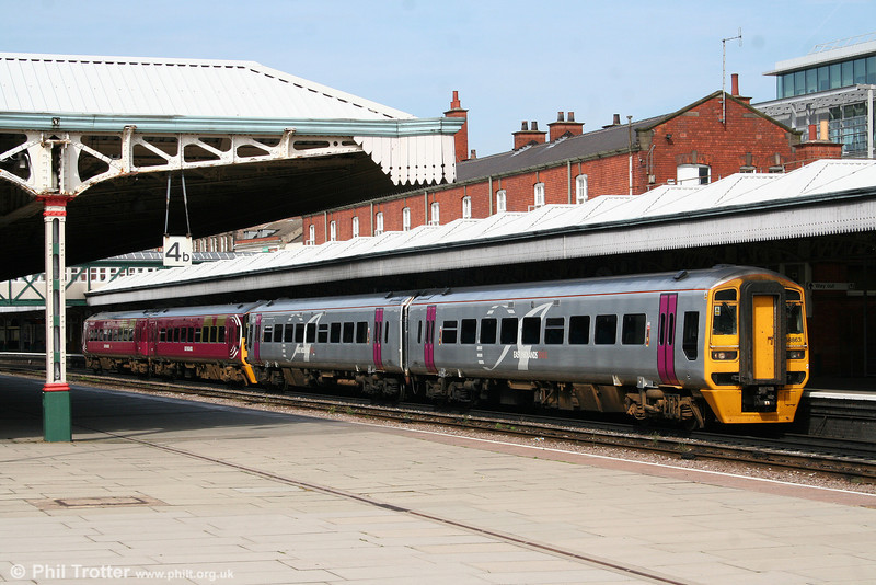 While refurbishment continues, a number of EMT class 158s still display evidence of previous owners. 158863 and 158777 are seen at Nottingham on 6th August 2009 with between them the remains of at least five different liveries!