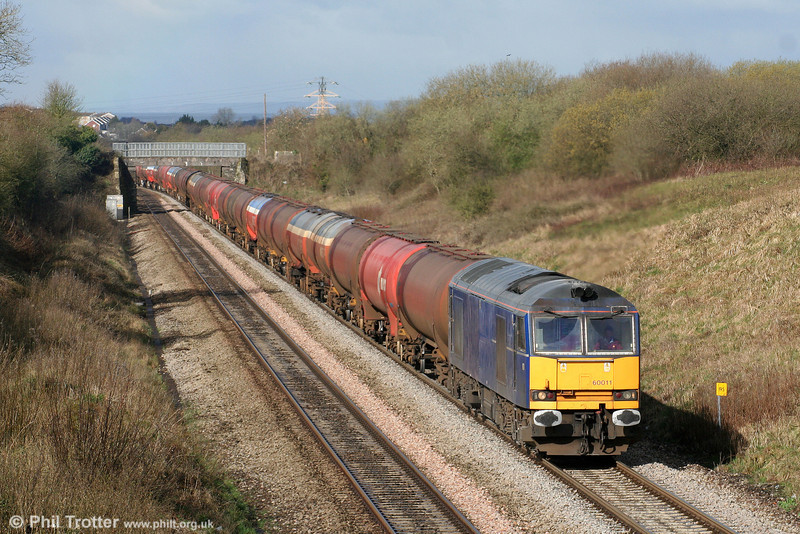 Making a change from the usual diet of EWS red and Railfreight grey class 60s, Mainline blue 60011 slowly climbs Stormy Bank with 6B13, 0510 Robeston to Westerleigh on 28th March 2009.