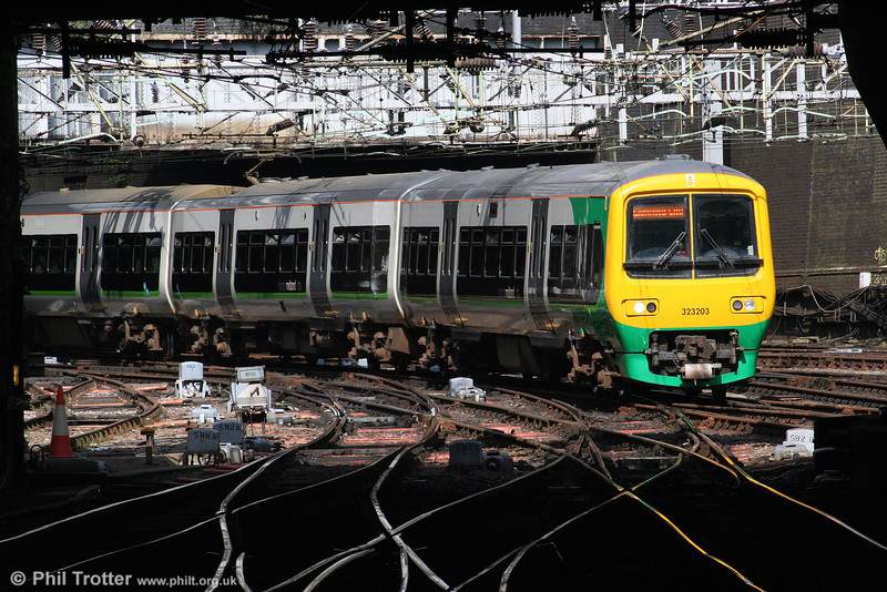 Photography at Birmingham New Street has always been something of a challenge. London Midland 323203 arrives with a cross-city service from Longbridge on 7th August 2009. It would appear that even rail travellers are not spared the sight of traffic cones...