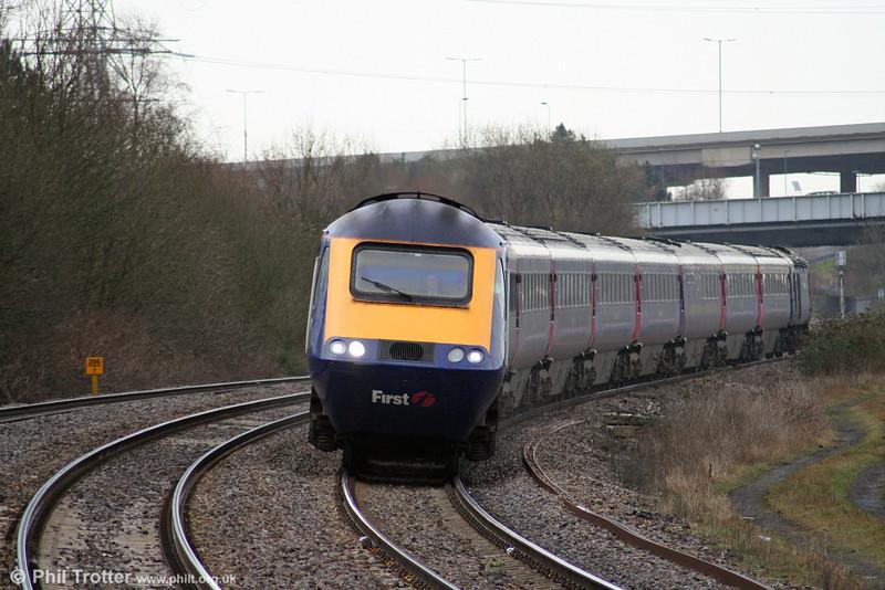 43091 heads the 0527 London Paddington to Swansea through Briton Ferry on 6th March 2009.