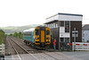 The driver of 153312 takes the token for the Pembroke Dock branch from the signalman at Whitland on 9th May 2009. 153312 was working the 0750 Swansea to Pembroke Dock.