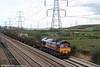 66177 passes Duffryn with 6V92, 1010 Corby to Margam empties on 7th April 2009. This loco is the prototype for cab modifications to improve drivers' working conditions with air conditioning and so on. One of the mods was to paint the top of the cabs white to reflect heat, as can be seen on the rear cab in this view - the front one being covered in dirt and exhaust soot!