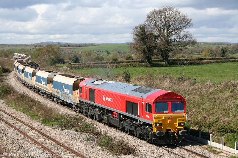Showing its new DBS livery to good effect in the sunshine, 59206 now renamed 'John F. Yeoman' descends from Bishton Flyover with 6C83, 1220 Machen to Westbury Yard on 7th April 2009.