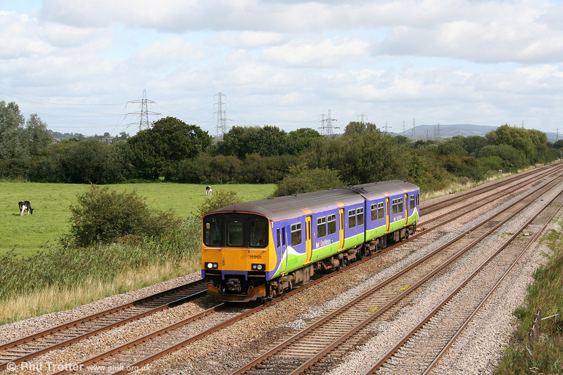 The 1011 Taunton to Cardiff Central in the shape of Sliverlink liveried 150121, passes Coedkernew on 29th August 2009.