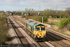 Freightliner 66607 runs light past Coedkernew as 0Z39 from Aberthaw Cement Works on 7th April 2009.