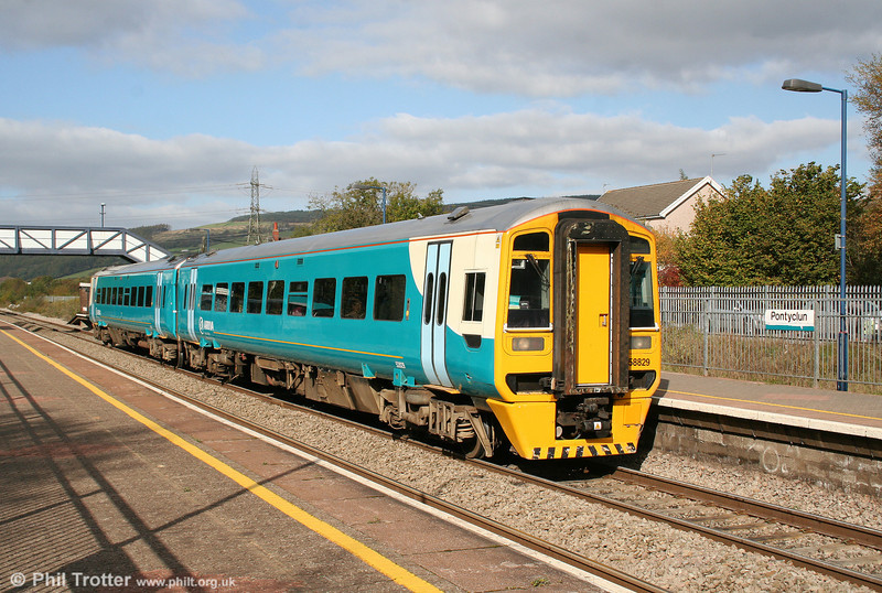 158829 forming the 1117 Maesteg to Cheltenham Spa calls at Pontyclun on 17th October 2009. The station was known as Llantrisant until its redevelopment in 1991.