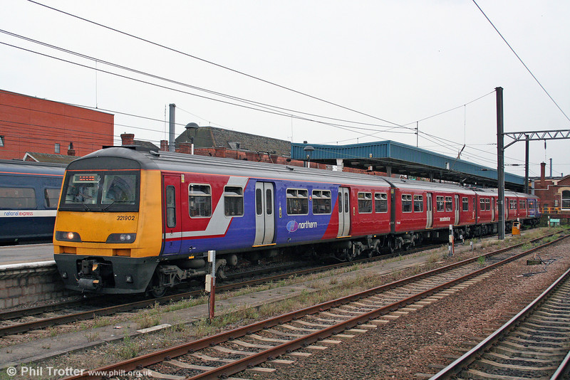 Northern has reliveried its 321/9s. 321902 awaits departure from Doncaster forming the 1614 stopper to Leeds on 6th August 2009.
