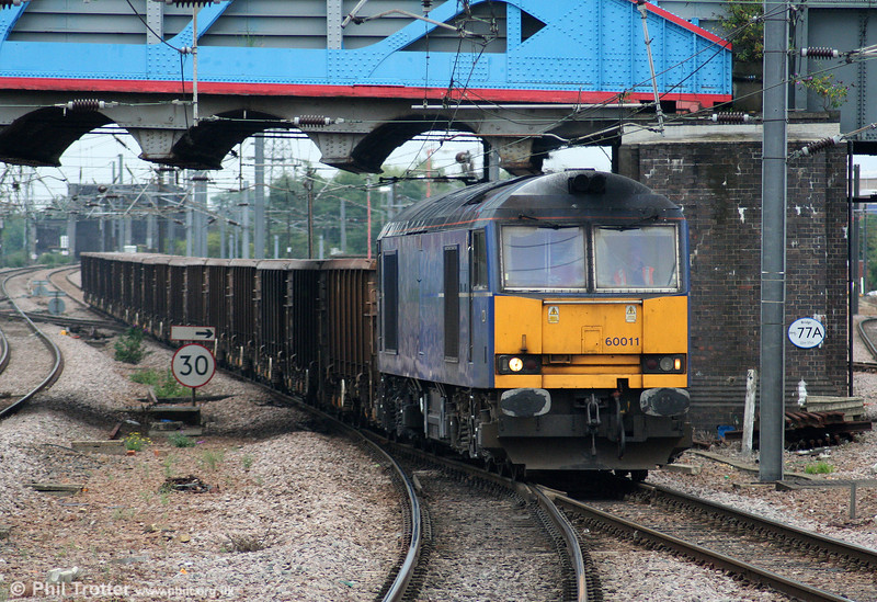 Mainline blue 60011 at Peterborough with 6M78, 1139 Hitchin Up Yard to Peak Forest empty stone on 4th August 2009.