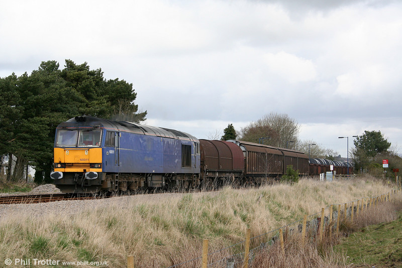 Mainline blue 60011 passes Llangennech with 6B41, 1305 Margam to Trostre additional on 4th April 2009.