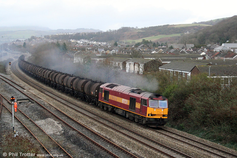 While all eyes were turned towards Gwaun Cae Gurwen on 16th January 2009, 60024 was making history further east. The loco is seen leaving a smokescreen over Briton Ferry as it passes with 6B60, 1028 Llandarcy to Newport ADJ; the second and final batch of TTA bitumen tanks which are due for scrapping, now that the bitumen flow has ceased.
