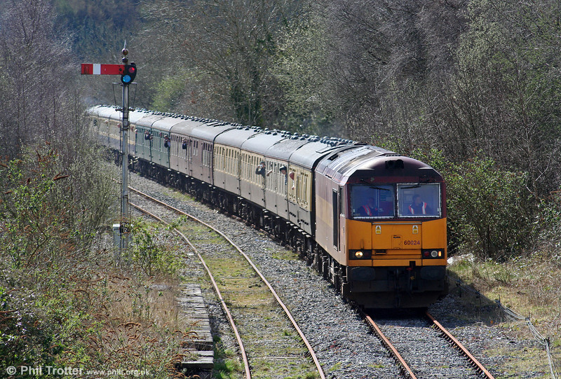 Reinstated from store at St. Blazey to cover this tour, 60024 approaches Tondu with Pathfinder's 1Z37, 0532 Nottingham to Machen via Tondu on 28th March 2009.