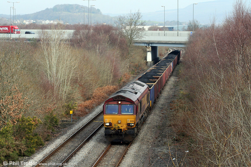66014 passes under the M4 at Llandarcy with 6F76, 1013 Parc Slip to Onllwyn on 31st January 2009.