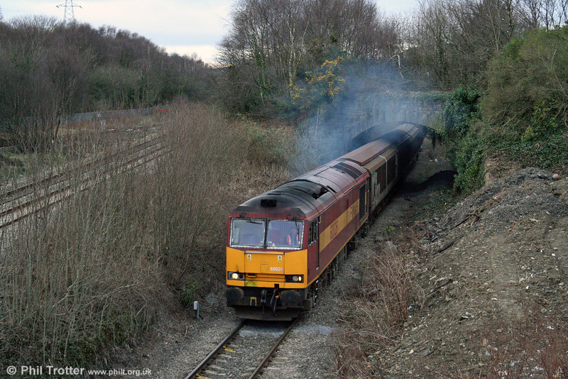 Get them while you can: With just 14 class 60s available for traffic, 60026 is seen at Briton Ferry Up Flying Loop with 6B64, 1625 Trostre to Margam empties on 22nd February 2009. The overbridge is a remnant of the former South Wales Mineral Railway from the Afan Valley to Swansea Docks.