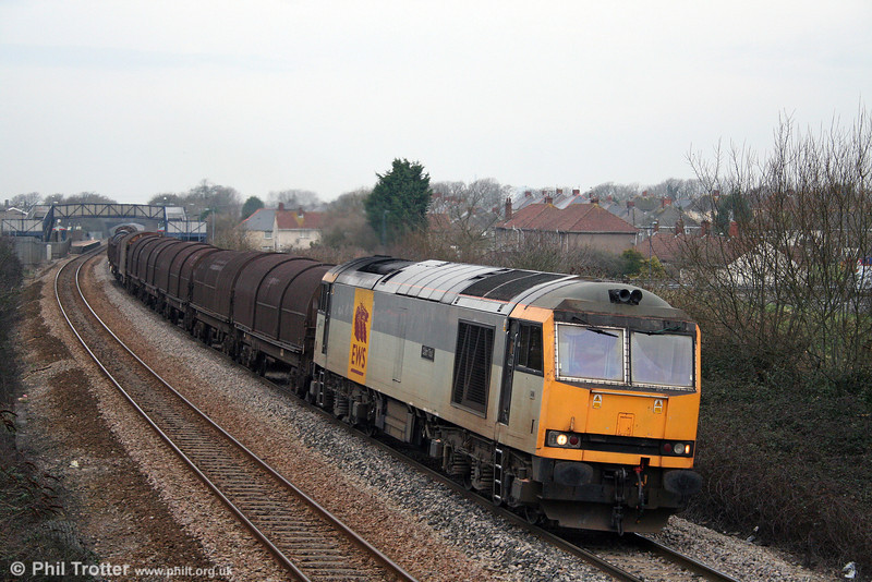 One of the few class 60s still in service, 60072 'Cairn Toul' passes Pyle with 6H25, 0952 Margam to Llanwern on 31st January 2009.