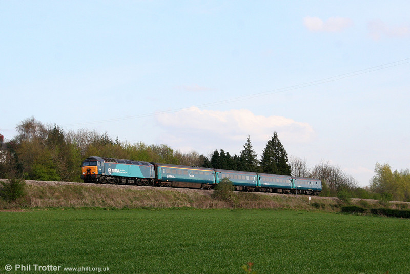 Arriva liveried 57314 approaches Abergavenny with 1W91, 1617 Cardiff Central to Holyhead on 13th April 2009.