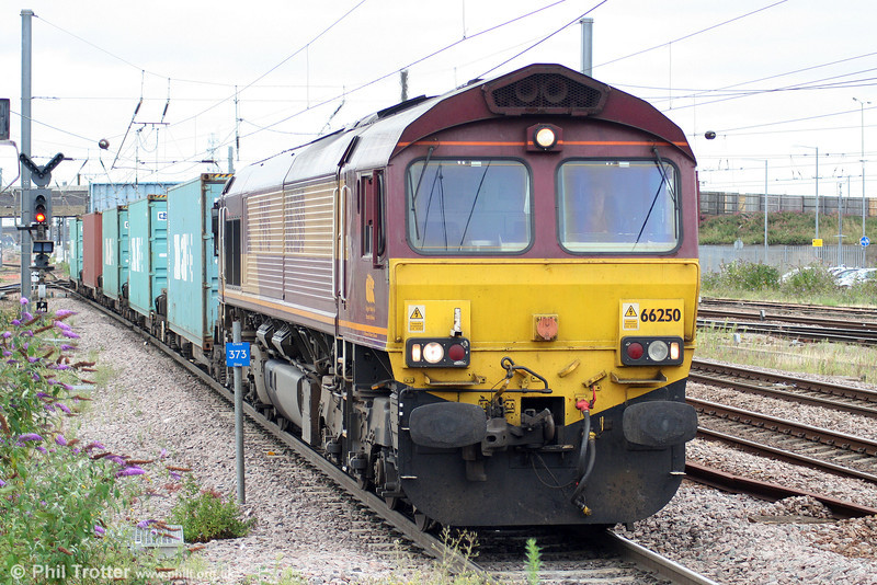 66250 is seen at Peterborough with 4L45, 0940 Wakefield Europort to Felixstowe on 4th August 2009.