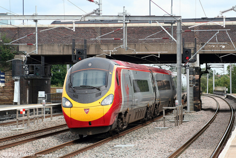 Another view of a 'Pendolino' heading for Manchester Piccadilly at Tamworth on 3rd August 2009.