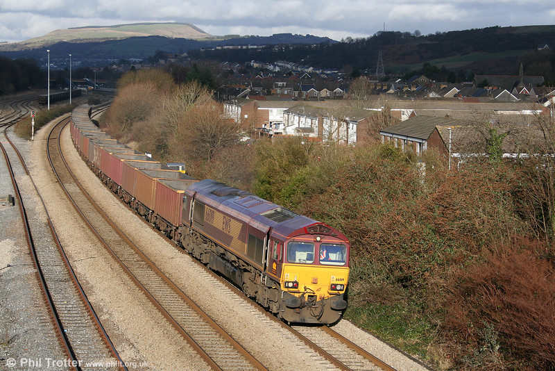 66019 emerges from the shadows at Briton Ferry with 6F81, 1350 Onllwyn to Margam on 24th January 2009.