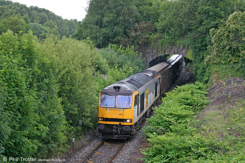 60013 'Robert Boyle' again, this time from the red nameplate side (!). The loco is seen in a summer downpour at Briton Ferry Up Flying Loop with 6B64, 1625 Trostre to Margam on 5th July 2009.