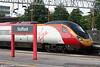 VWC Pendolino 390011 'City of Lichfield' pauses at Stafford while working the 1648 Liverpool Lime Street to London Euston on 5th August 2009.
