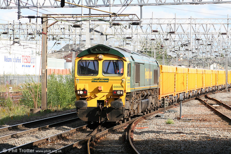 66605 approaches Stafford with 6C64, 1348 Mountsorrel to Carlisle loaded ballast boxes on 5th August 2009.