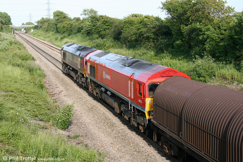 66057 with DB liveried 66152 pass Stormy with 6E20, 1835 Margam to Immingham on 11th June 2009.
