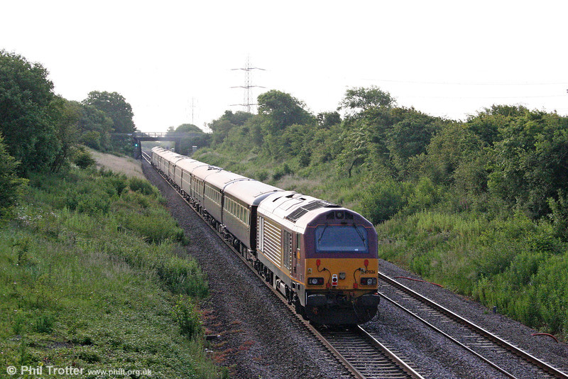67026 brings up the rear of the Northern Belle ecs on Stormy Bank with 5Z66, 0605 Margam to Cardiff Central on 20th June 2009.