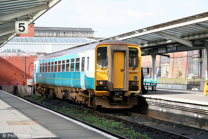 153320 prepares to leave Shrewsbury with the 1405 Heart of Wales Line service to Swansea on 14th March 2009.