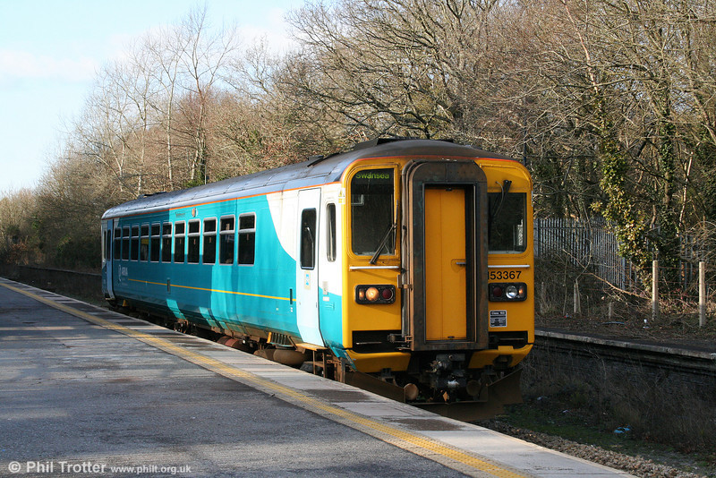 153367 calls at Gowerton forming the 1310 Tenby to Swansea on 1st February 2009.