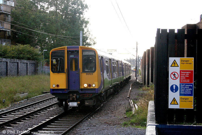 313123 is seen approaching Finchley Road & Frognal on the North London Line, forming the 1511 Richmond to Stratford on 24th October 2009.