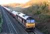 Sunrise at Stormy: 60085 'Mini - Pride of Oxford' climbs Stormy Bank one last time with 6B13, 0510 Robeston to Westerleigh on 12th December 2009. This working was handed over to pairs of class 66s from 14th December.