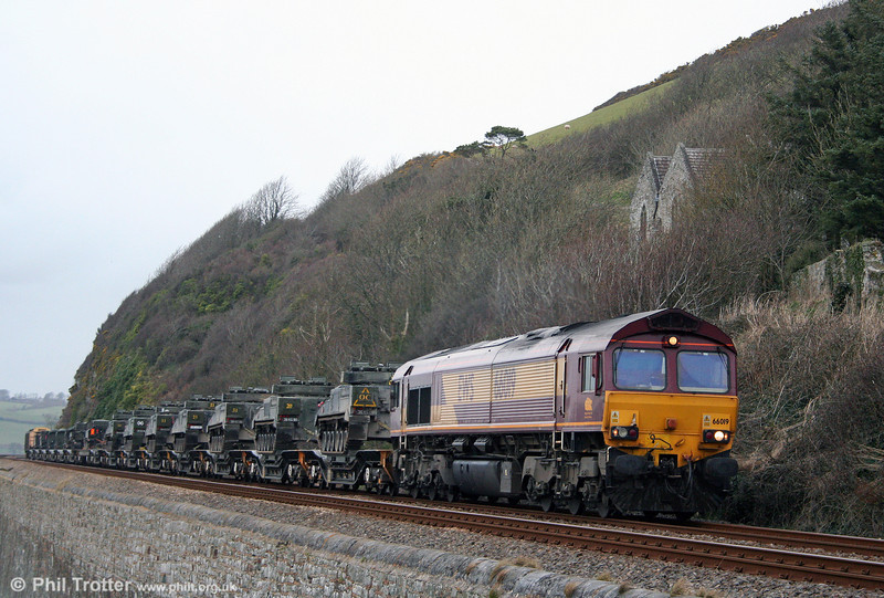 Freight in deepest West Wales is nowadays something of a rarity, normally being confined to the daily fuel trains from Robeston and the occasional working involving military hardware. On the 'other' sea wall, 66019 passes St. Ishmaels with 7X39, 1424 Haverfordwest to Didcot MoD train on 9th March 2009.
