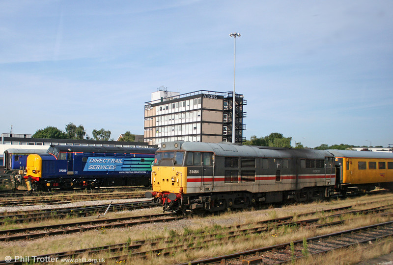 31454 stabled at Derby RTC on 6th August 2009. In the background is DRS 37259, recently outshopped from RVEL, Derby.