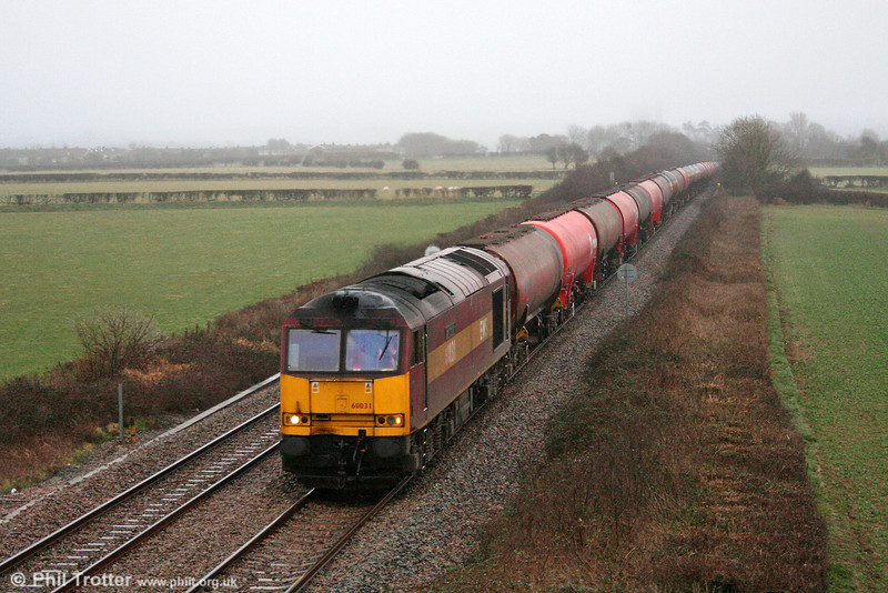 With the light fading and in poor weather conditions, 60031 'ABP Connect' passes St. Athan with the diverted 6B33, 1322 Theale to Margam on 7th March 2009.