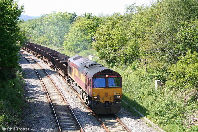 66002 'Lafarge Quorn' is caught at Allt y Graban with 6B64, 1625 Trostre to Margam on 24th May 2009.