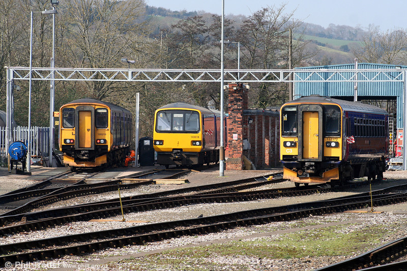 Three flavours of dmu at Exeter Depot on 21st March 2009. Left to right: 150218, newly refurbished 143618 and 153372.
