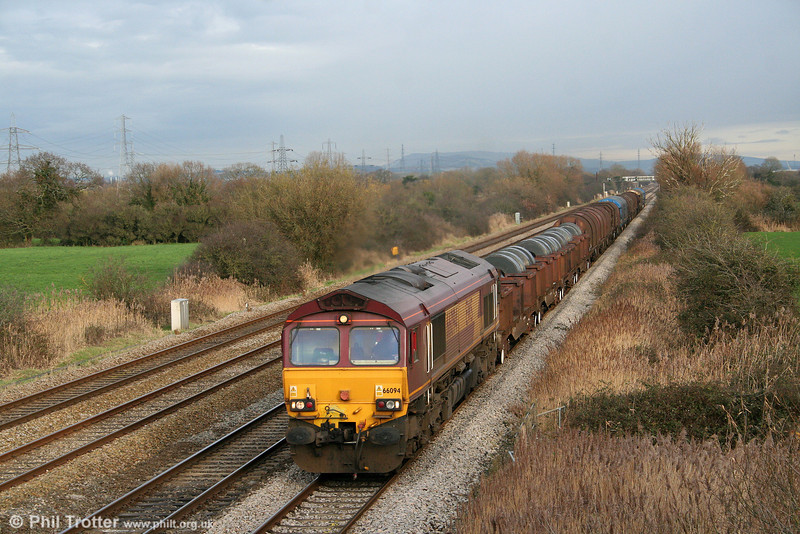 66094 at Coedkernew with 6H26, 1334 Llanwern to Margam on 19th December 2009.