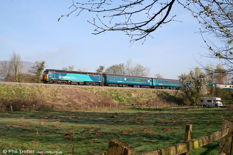The early morning mist is still clearing from the hillsides as Arriva liveried 57314 heads 1V31, 0532 Holyhead to Cardiff Central through Pandy on 13th April 2009. The moles are clearly quite active around these parts!