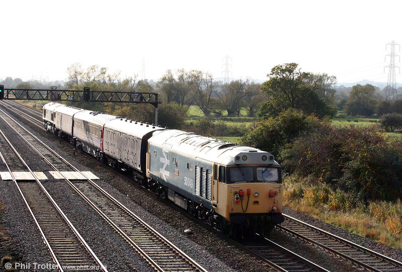 50049 'Defiance' passes Coedkernew at the rear of 5Z84, 0820 Carlisle to Cardiff Canton headed by GBRf 66704 on 17th October 2009. 50049 was being transferred to the Pullman Group workshops at Canton for a bogie overhaul.