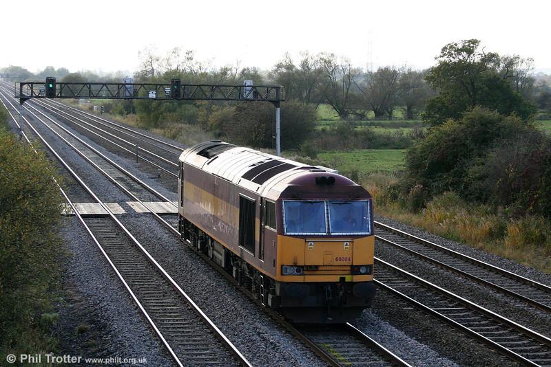 60004 returns through Coedkernew running as 0Z20, 1610 Cardiff Tidal to Newport ADJ on 17th October 2009.