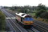 60004 returns through Coedkernew running as 0Z20, 1610 Cardiff Tidal to Newport ADJ on 17th October 2009.