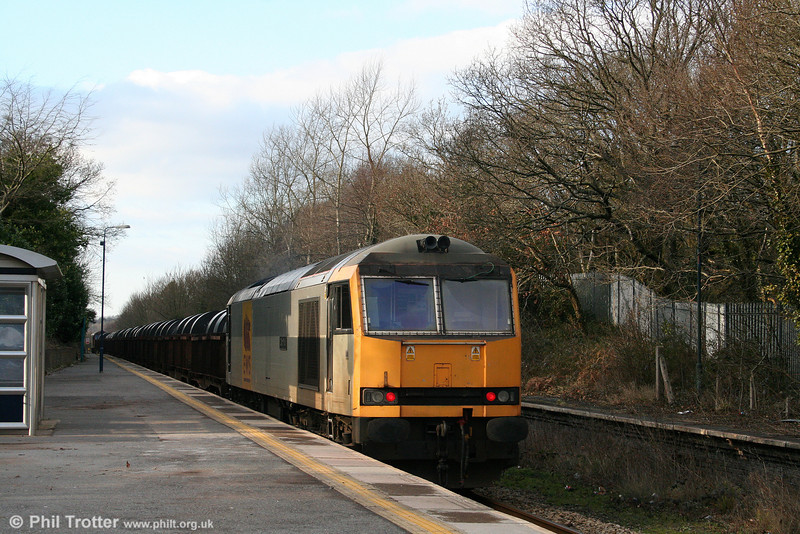 60072 'Cairn Toul' is seen at Gowerton, bringing up the rear of 6B12, 1414 Margam to Trostre on 1st February 2009.