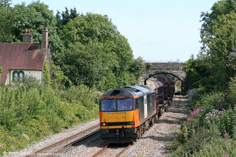 Load Haul liveried 60059 'Swinden Dalesman' passes Pyle with 6H26, 1528 Llanwern to Margam empties on 9th August 2009.