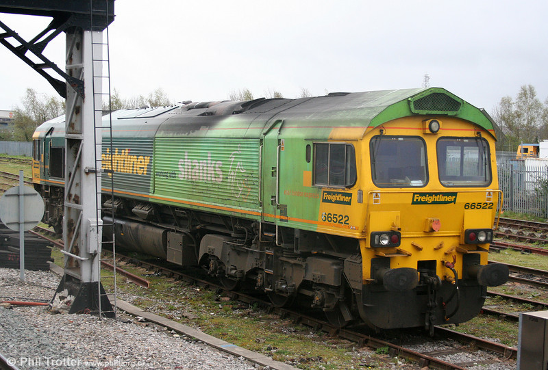 A class 66 livery variation not previously featured in these pages is that carried by Freightliner 66522, one half of which carries a light green scheme for Shanks Waste. The (grubby!) loco is seen at Bristol Kingsland Road stabling point on 9th April 2009.